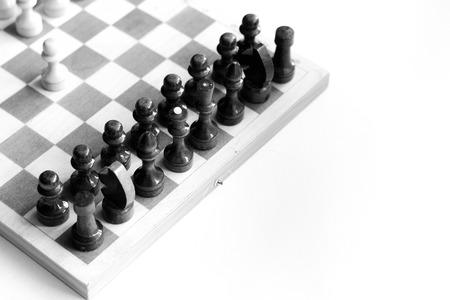 battle plan: black white checkerboard on white background