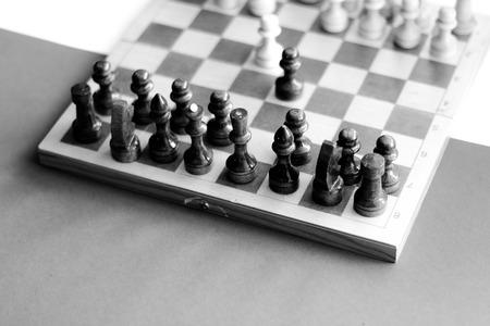 battle plan: black white checkerboard with figures on black white background Stock Photo