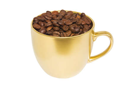 Gilded cup with coffee beans isolated on white background Foto de archivo
