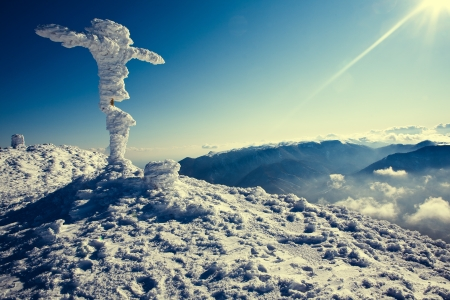 Winter top of the mountain with a cross Stock Photo