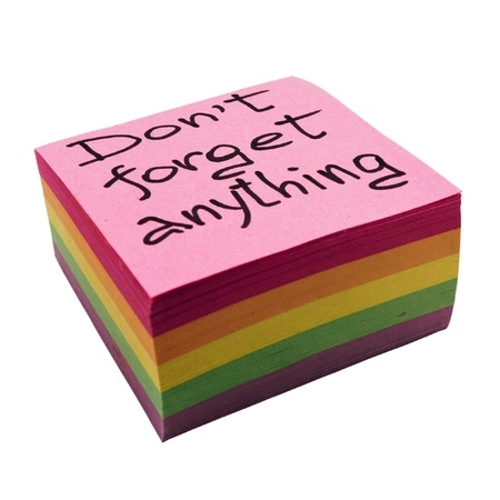 Don t forget a reminder - the block of multi-colored notes on a white background