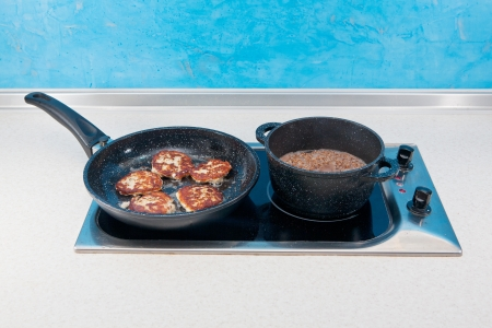 nonstick: ccutlets and buckwheat cereal in a ware with nonstick covering on a glass-ceramic cooktops