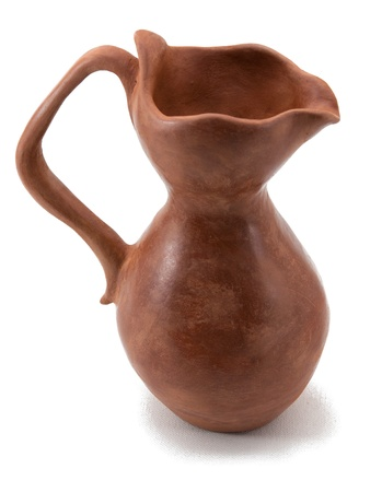 ancient jug from ceramics on a white background Stock Photo