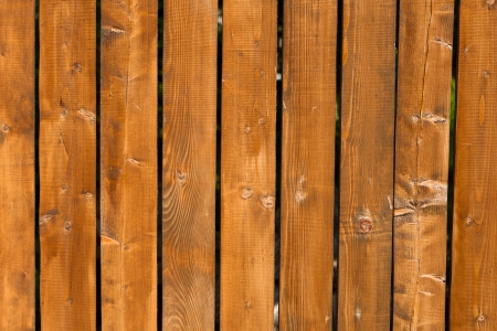 new pine wood fence painted brown color background Stock Photo