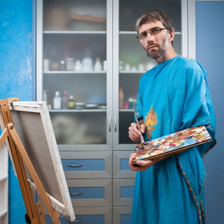 an artist paints a picture in the studio on canvas Stock Photo - 14719036