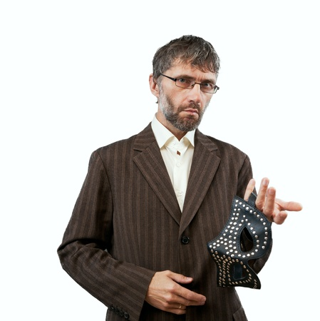 spectacular man in a suit proposes BDSM mask Stock Photo - 14719031