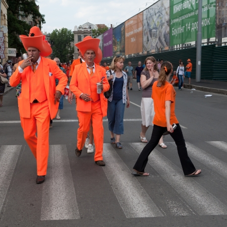 KHARKIV, UKRAINE - 09 JUNE: Holland football team supporters walk on a street of Kharkiv city before UEFA EURO 2012 game against Denmark on 9 June, 2012 in Kharkiv, Ukraine