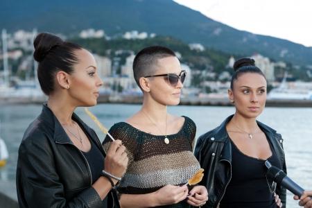 interviewed: YALTA, UKRAINE - AUGUST 29, 2012: lead singer of girl group Nikita Dasha Astafieva is interviewed TV on the seafront of Yalta before Crimea Music Festival on August 29, 2012 in Yalta, Ukraine Editorial