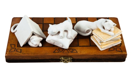 cat ceramics figurines on the wooden box - Isolated white photo