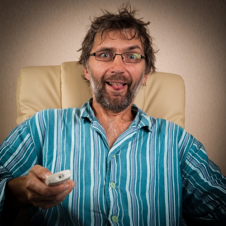 foolish man looks piquant show on TV Stock Photo - 15127553