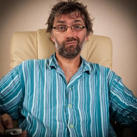 foolish man looks improbable show on TV Stock Photo - 15127574