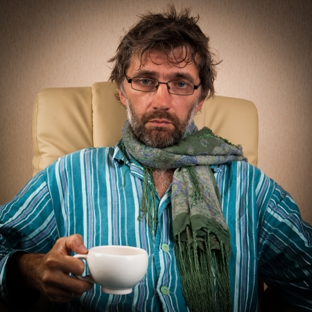 mature sick man sitting in chair with cup Stock Photo - 15127550