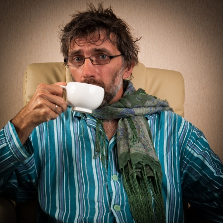 mature sick man sitting in chair with cup Stock Photo - 15127551