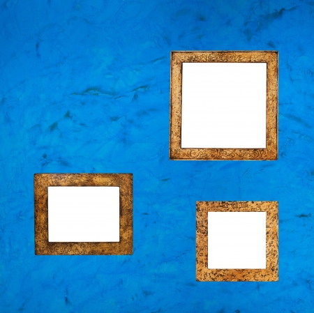 antique picture frames on the blue background photo