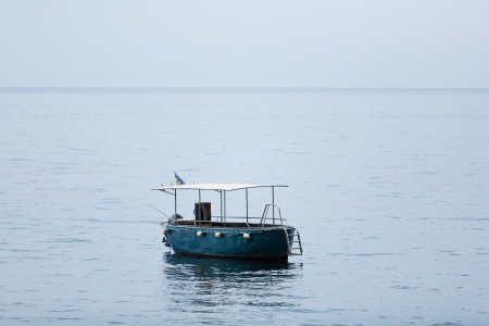 empty fishing boat with gear on high seas Stock Photo - 15903015