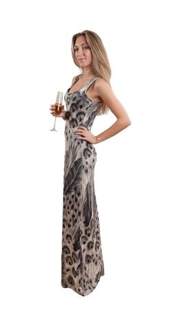 Mujer joven atractiva en vestido de fiesta bebiendo champ�n aislado blanco Foto de archivo