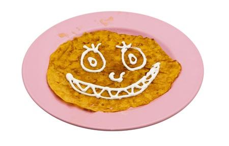 Homemade fried pumpkin pancake for halloween isolate white Stock Photo