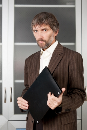 man in suit with business papers in folder Stock Photo - 16651296
