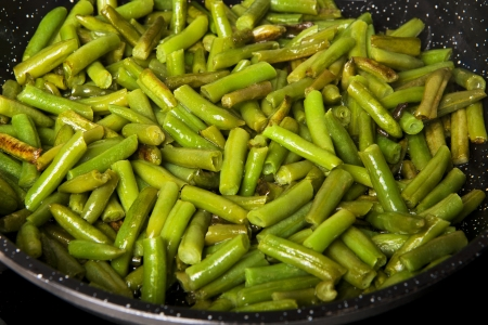 nonstick: fried green beans in oil frying pan
