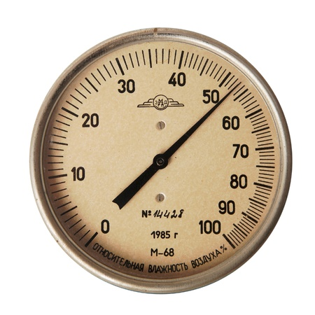vintage arrow hygrometer isolated over white background