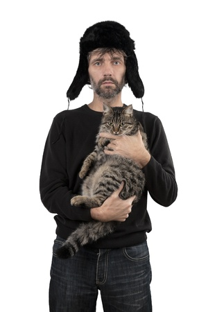 adult man in hat ear flaps holding cat isolated white Stock Photo - 17395019