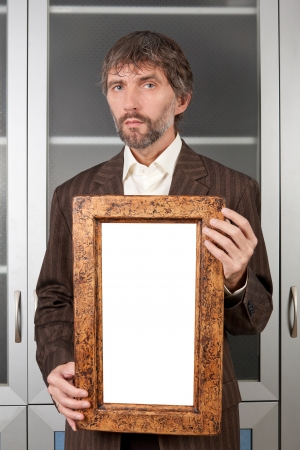 man in suit with picture in old frame Stock Photo - 16756890