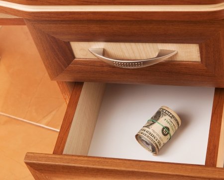 roll of United States dollars in open desk  drawer Stock Photo - 16834521
