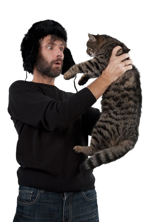 adult man in hat ear flaps holding cat isolated white Stock Photo - 16826434