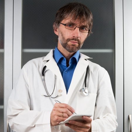 doctor writes in a notebook to the clinic Stock Photo - 16826435