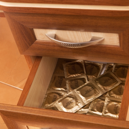 many tapes of condoms in open desk  drawer