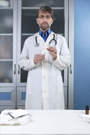 doctor preparing injection to the clinic Stock Photo - 17277980