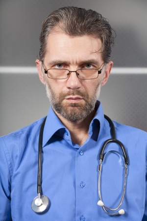 serious doctor with a stethoscope and glasses Stock Photo - 18192551