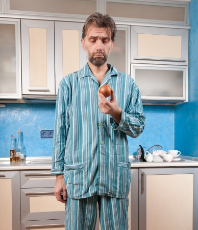 mature drunk man standing in pajamas with onion Stock Photo - 18323492