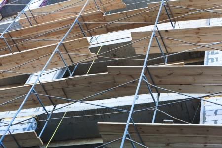 concrete wall of construction building with scaffolding photo