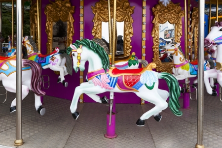 Carousel Horses on carnival Merry Go Round photo