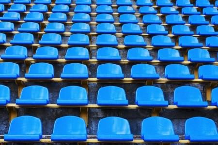 amphitheater of dark blue seats abstract background Stock Photo