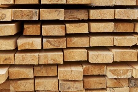 stack of pine boards on building materials warehouse
