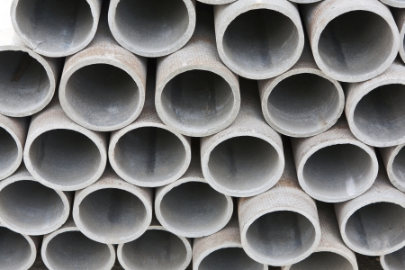pile of cement pipes on building materials warehouse photo