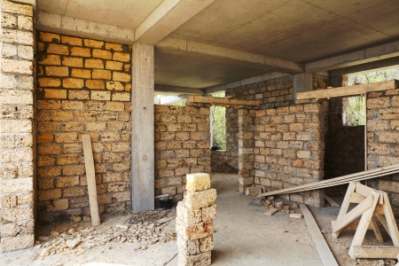 building house of concrete frame with walls from shell rock