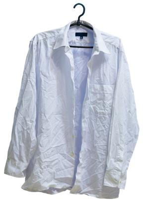 wrinkled male white laundered shirt on hanger