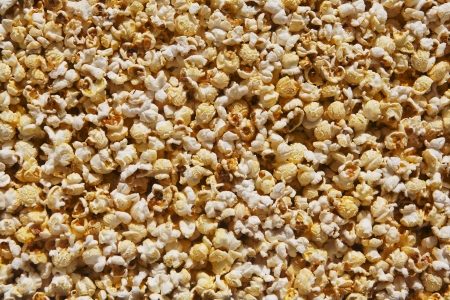 microwave popcorn behind the glass natural food background photo