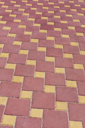 diagonal rows of red and yellow paving slabs