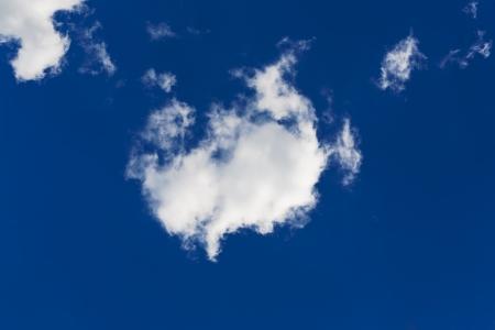 white clouds in a clear blue sky