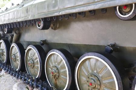 military vehicles running gear on tracks closeup Stock Photo