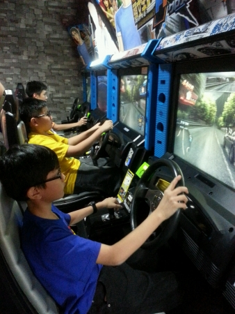 Asian Kids Playing Arcade at The Arcade Centre Stock Photo