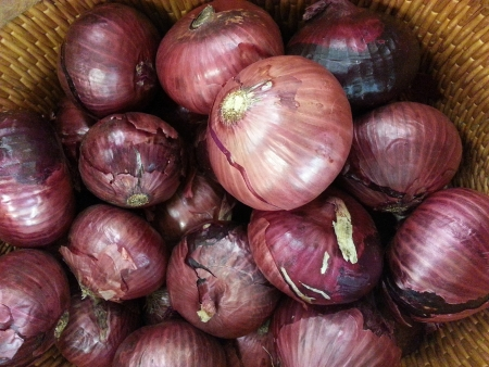Basket of red onions