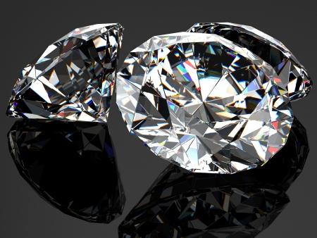 diamond stones: Three diamonds on the black glossy surface.
