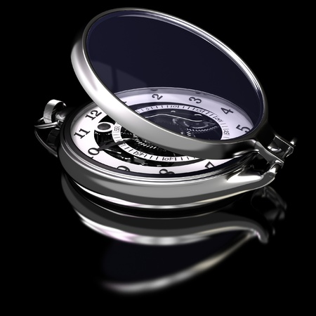 Pocket watch on a black glossy surface.