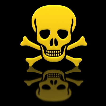 Yellow skull and crossbones on a black glossy surface. photo