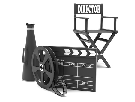 Film industry  directors chair with film strip and movie clapper photo